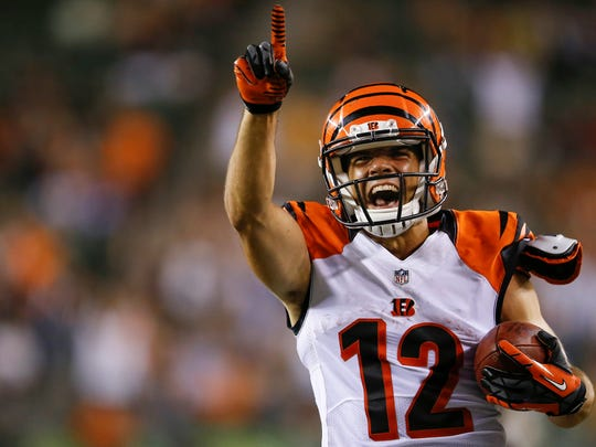 Cincinnati Bengals wide receiver Alex Erickson (12) returns a punt for a touchdown in the fourth quarter during the NFL Week 1 preseason game between the Cincinnati Bengals and Minnesota Vikings, Friday, Aug. 12, 2016, at Paul Brown Stadium in Cincinnati. The Vikings won 17-16.