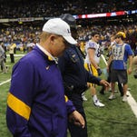 LSU coach Les Miles walks off the field after the Allstate BCS national Championship game Monday January 9, 2012 in New Orleans, Louisiana.