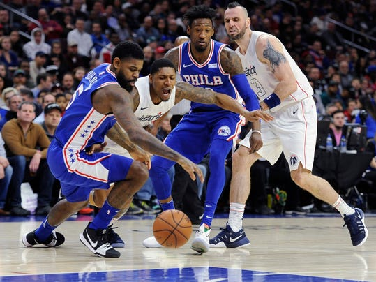 Washington Wizards' Bradley Beal (3) and Philadelphia 76ers' Amir Johnson (5) chase down a loose ball in the first half of an NBA basketball game, Tuesday, Feb 6, 2018, in Philadelphia. (AP Photo/Michael Perez)