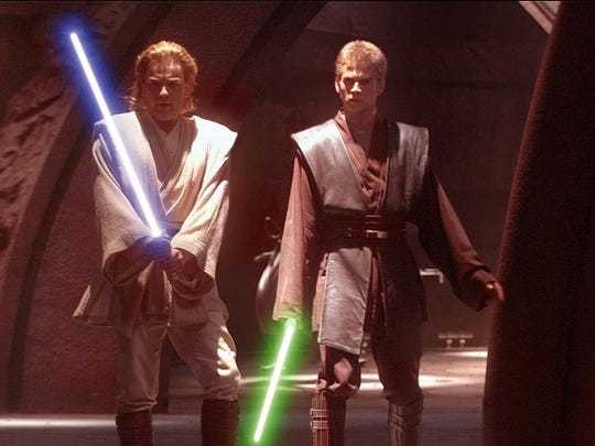 "Ewan McGregor, left, and Hayden Christensen in a scene from the motion picture ""Star Wars: Episode II Attack of the Clones."""
