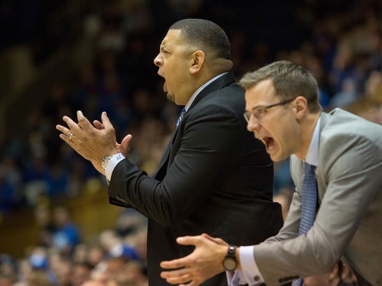 Duke's acting head coach Jeff Capel, left, and assistant coach Jon Scheyer, right, shout to their team during the second half of an NCAA college basketball game against Boston College in Durham, N.C., Saturday, Jan. 7, 2017. Duke defeated Boston College 93-82. (AP Photo/Ben McKeown)