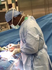 Dr. Cedrek McFadden in the OR