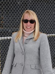 Dawn Dowling-Mann, vice president and softball director of the City of Poughkeepsie Youth Baseball and Softball League, pictured in Spratt Park in the City of Poughkeepsie.