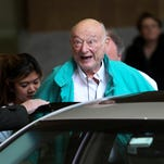 Former New York mayor Ed Koch says goodbye to reporters as he gets in his car after being released from the hospital in New York in December 2012.  He died Feb. 1 from congestive heart failure.