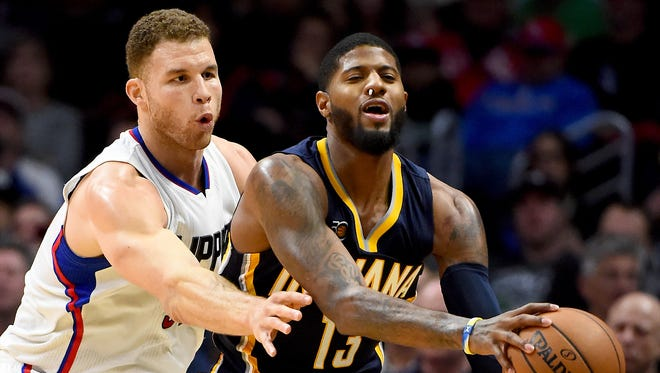 Los Angeles Clippers forward Blake Griffin (32) guards Indiana Pacers forward Paul George (13) in the first half of the game at Staples Center.