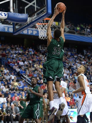 Trinity center Ray Spalding slams an alley-oop during the second half of the KHSAA Boys Sweet Sixteen Basketball Tournament game between Trinity and Hopkinsville at Rupp Arena in Lexington, KY. Friday, March 21, 2014. Trinity won the game 74-56. Photo by Mike Weaver, Special to the C-J.