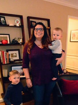 Carolyn Stack and her children, Duke 3 (front) and Dominic 1 (right), are shown in their Ocean Twp. home. Frank Galipo/Correspondent