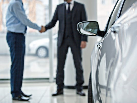 Buying new car at car showroom