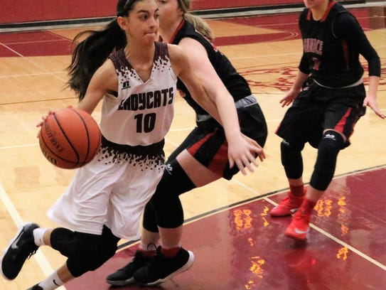 Tularosa's Allysa Montoya tries to drive past a Eunice