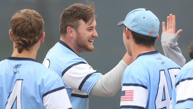 John Jay's Jack Matero is all smiles as he is greeted by teammates after hitting a game-tying RBI triple in the bottom of the 7th inning against Mahopac during baseball action at John Jay High School in East Fishkill May 4, 2017. John Jay won the game 3-2 in the bottom of the 7th with a walk-off walk.