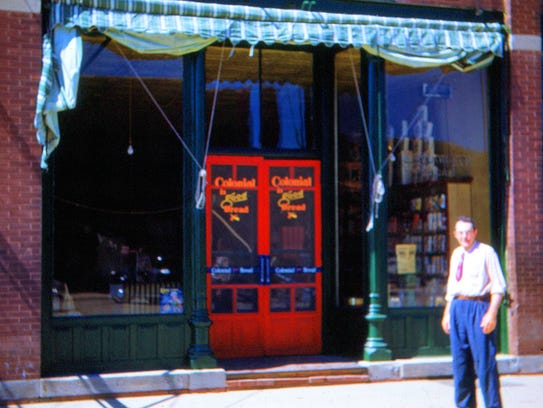 Al Byrne is shown in front of his store in 1951 in