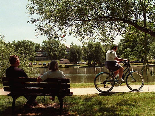 Stratford tourists and bicyclists often spend some leisure time along the picturesque Avon River.