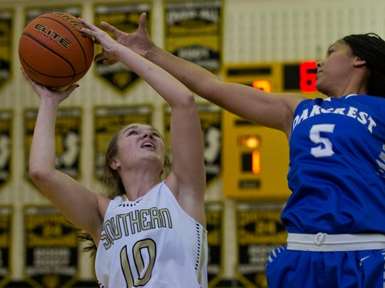 Southern Regional's Colleen Brady looks for an opening against Oakcrest's Brielle Smith during first half aciton. Southern Regional Girls Basketball vs Oakcrest  in Score at the Shore tournament at Southern Regional High School on December 26, 2015 in Stafford NJ.