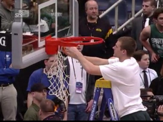 Matt Van Dyk cuts down the net after MSU's win Sunday over Louisville in the Elite Eight at the Carrier Dome in Syracuse, N.Y.
