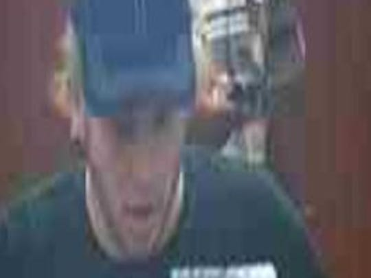 Police are searching for male suspect wearing a Red Hot Chili Peppers shirt after a bank robbery in Clifton.
