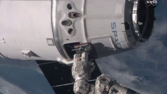 SpaceX's Dragon capsule is shown after being grappled by the International Space Station's robotic arm Jan. 12, 2015.