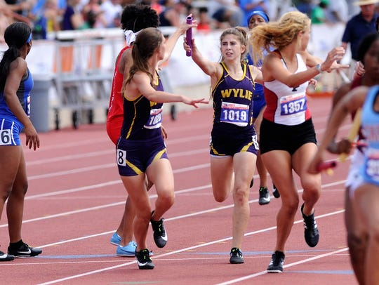 Wylie's Abbigayle Gollihar, right, passes the baton to Abbey Henson after the second leg of the Class 4A girls mile relay at the UIL State Track and Field Championships at the University of Texas' Mike A. Myers Stadium in Austin on Saturday. Wylie won the bronze medal.