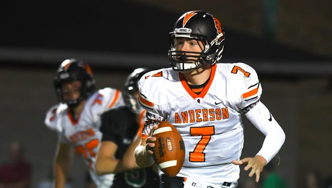 Jay Volpenhein of Anderson runs out of the pocket against Harrison.