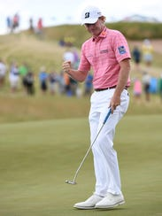 Brandt Snedeker reacts to his putt on the ninth green