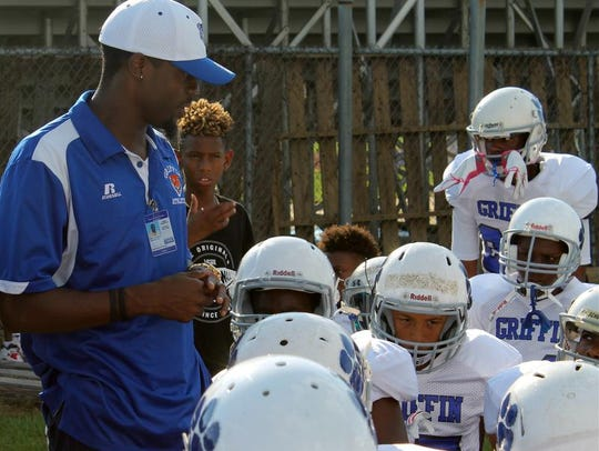 Coach Brett Stanley speaks to players.