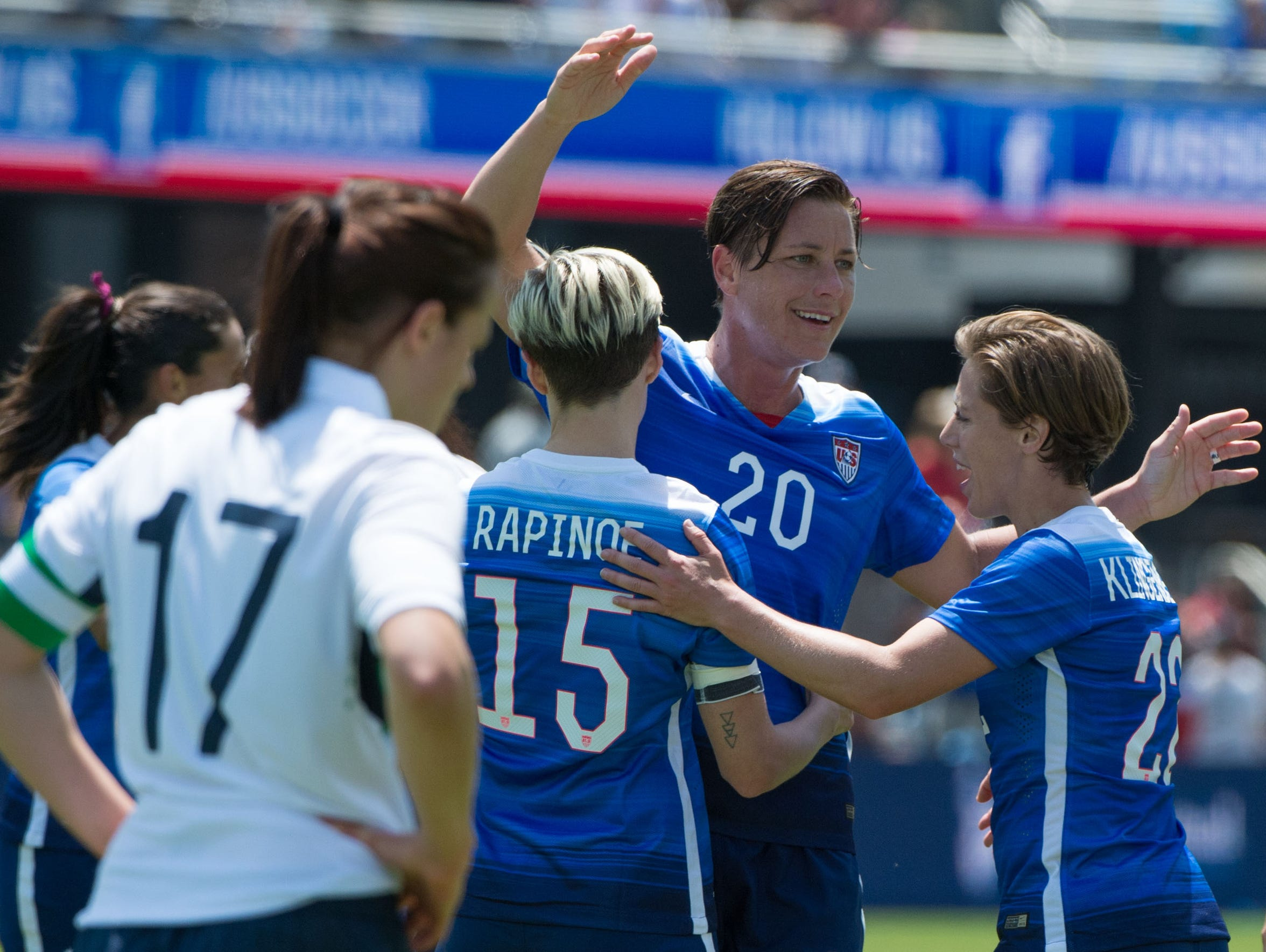 Abby Wambach (20) is congratulated for scoring a goal