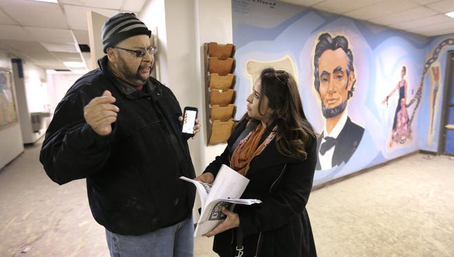 Miguel Juarez of the Lincoln Park Conservation Committee gives a tour of the Lincoln Center to National Trust for Historic Preservation Field Officer Sehila Mota Casper Wednesday. The committee has been trying to save the center, which is currently owned by TxDOT, from demolition.