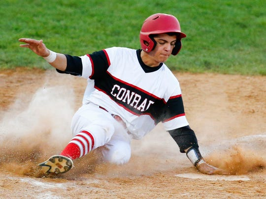 Conrad's Kevin Russo scores in the first inning against Salesianum in a DIAA state tournament semifinal at Frawley Stadium Thursday.