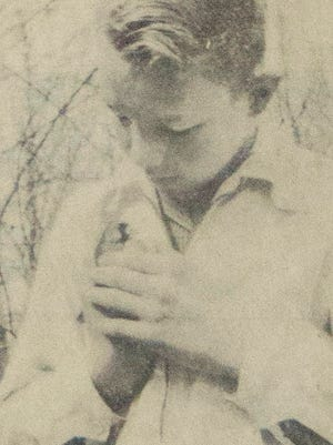 A young birder with a sora rail at the 1956 bird breakfast.