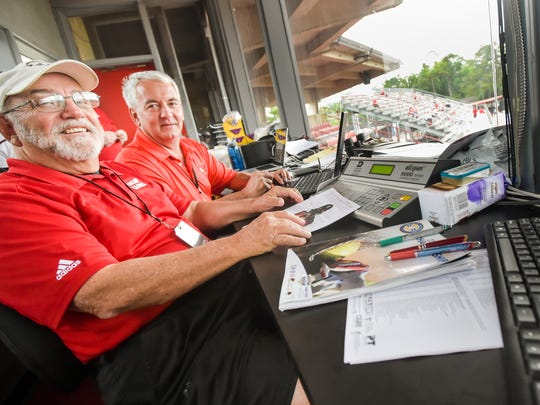 Scoreboard operator Guy Rials (left) and official Dan McDonald in the press box at The Tigue, which is set for major renovation.