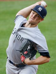 Jul 11, 2018; Baltimore, MD, USA;  New York Yankees starting pitcher Sonny Gray (55) pitches during the first inning against the Baltimore Orioles at Oriole Park at Camden Yards.