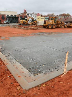 Anderson City Council members agreed Monday to spend up to another $44,000 to finish a parking lot and build a garbage enclosure near the downtown Bleckley Station event center.