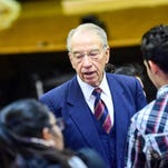 U.S. Senator Chuck Grassley chats with students on Monday, November 23, 2015, during a visit to East High School.