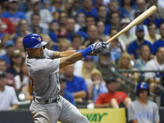 Chicago Cubs' Addison Russell drives in a run with a base hit during the seventh inning of a baseball game against the Milwaukee Brewers, Saturday, July 23, 2016, in Milwaukee. (AP Photo/Benny Sieu)