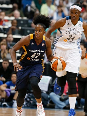 Indiana Fever guard Shenise Johnson (42) brings the ball up court against the Minnesota Lynx in the first half of Game 2 of the WNBA basketball finals, Tuesday, Oct. 6, 2015, in Minneapolis. (AP Photo/Jim Mone)