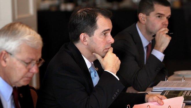 Gov. Scott Walker, then-chairman of the Wisconsin Economic Development Corp., participates in a WEDC board meeting in late 2013 in La Crosse.