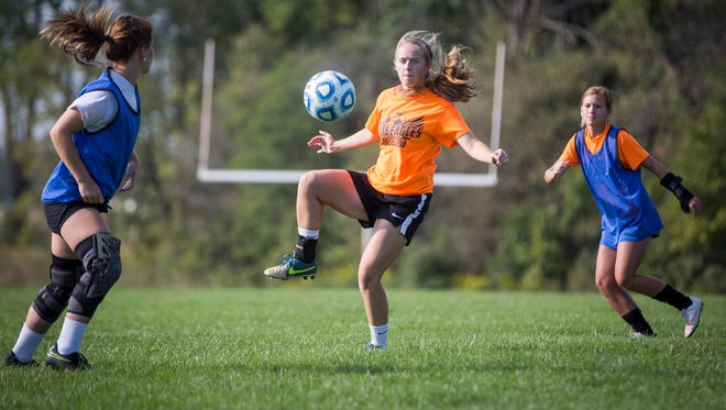 Bailee Allen practices drills during a Delta practice on Tuesday afternoon at Delta High School.