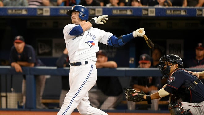 Blue Jays third baseman Josh Donaldson hits a home run against the Twins in the first inning at Rogers Centre.