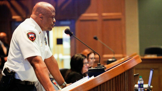 In this file photo, Deputy Chief Reggie Thomas addresses a meeting of the Lafayette City-Parish Council on Aug. 4, 2016.
