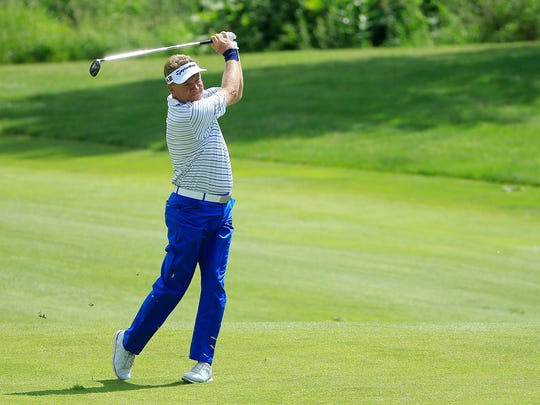 Paul Broadhurst hits his second shot on the ninth hole.