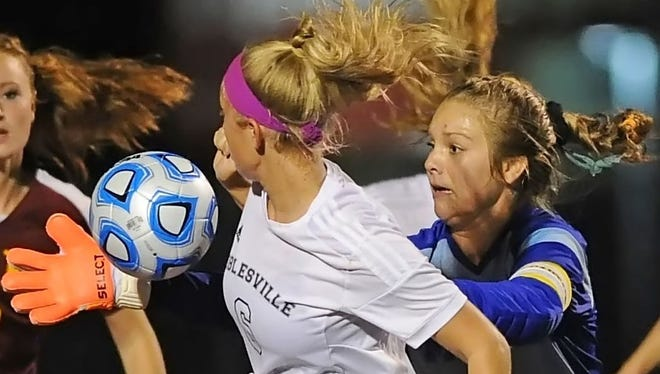Maverick senior goalkeeper Laura Shake gets a mitt on the ball to stop a drive by Noblesville Wednesday night at Logansport.