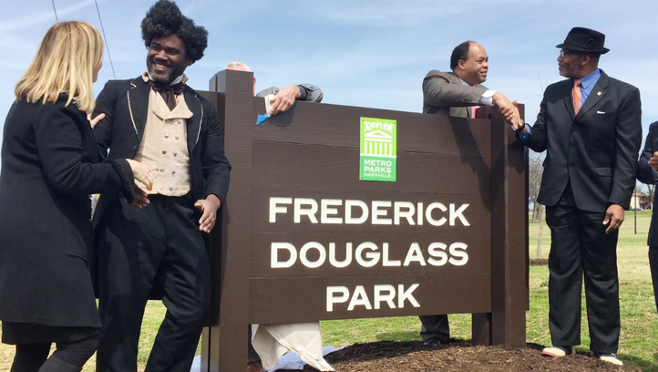 Mayor Megan Barry, left, shakes the hand of Frederick Douglass impersonator Bakari King at the restoration ceremony for Frederick Douglass Park on Wednesday, March 22, 2017. Douglass' great-great-grandson Kevin Douglass Greene, far right, shakes the hand of local attorney David Ewing, who helped with the research to get the park's name restored to honor the abolitionist.