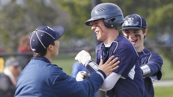 Brighton senior Ernie Clement, shown here after an inside-the-park home run, is headed to  the University of Virginia on an athletic scholarship.