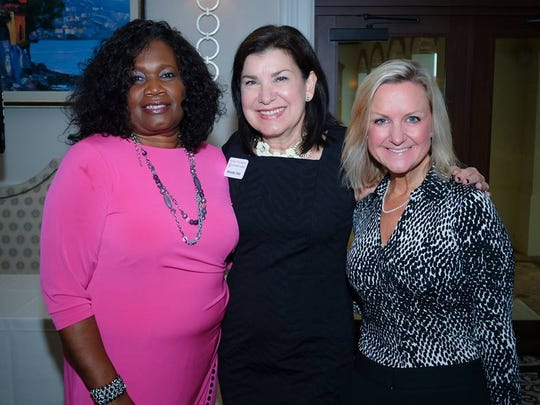 Brenda Tate, center, poses with board members of the Women's Foundation of Southwest Florida, Gail Williams, left, and Christin Collins.