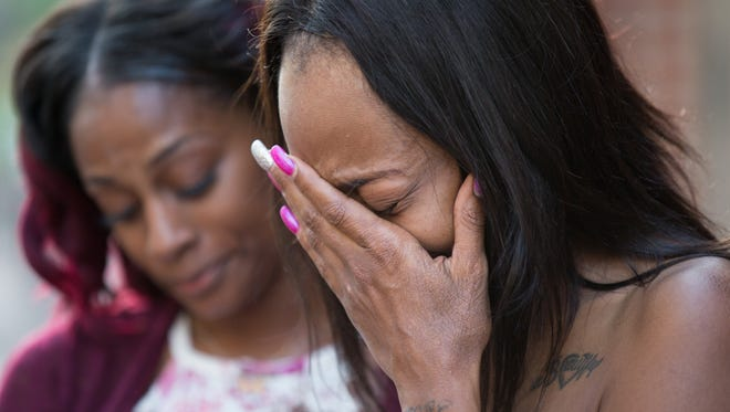 From left,  Angela and Erica Bailey, daughters of Aaron Bailey, react to the Civilian Police Merit Board decision outside of the City-County Building in Indianapolis on Thursday, May 10, 2018. The Civilian Police Merit Board found that the officers who fatally shot Aaron Bailey did not violate IMPD prolicy. Aaron Bailey, 45, was unarmed when he was fatally shot on June 29 after a traffic stop, short pursuit and minor crash.