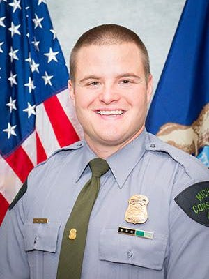 Michigan Department of Natural Resources Conservation Officer Mark Zitnik was off-duty boating with his family and friends July 25 when he rescued a man from drowning in Lake Superior. Zitnik patrols Alger County and has been a conservation officer since January 2015.