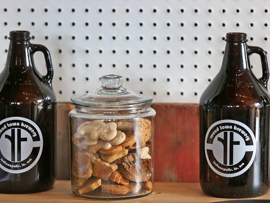 Dog treats and growler bottles sit on the counter at