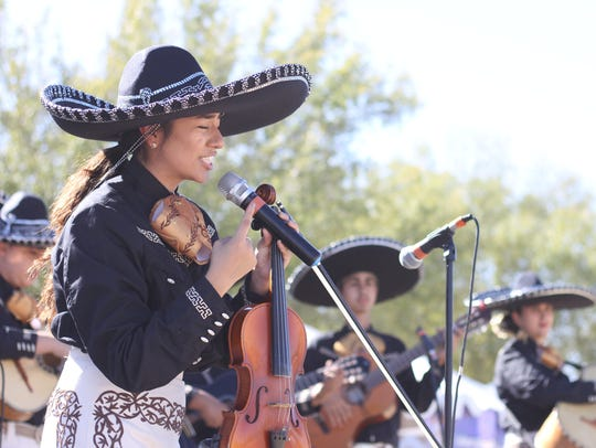Members of the Mariachi Juvenil de Mi Tierra play at