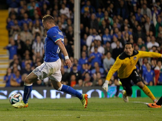 Italy's Ciro Immobile, left, goes past Republic of Ireland's goalkeeper David Forde to put the ball in the net but is ruled off-side during their international friendly soccer match at Craven Cottage, London, Saturday, May 31, 2014. (AP Photo/Sang Tan)