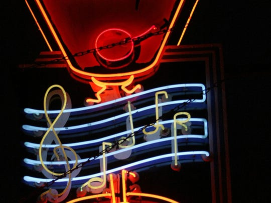 The notes on the neon sign outside the Red Key Tavern