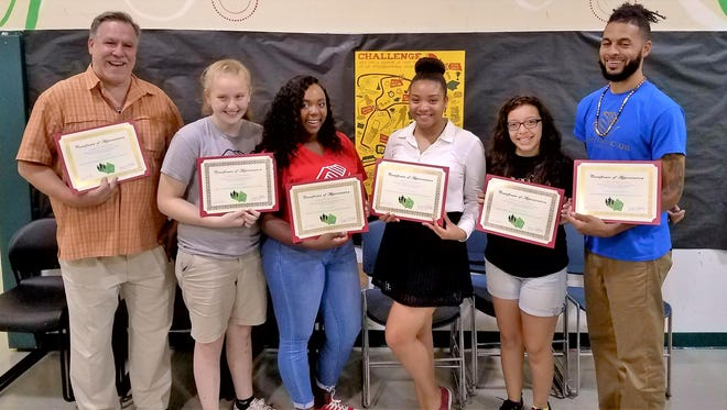 (From left) Boys & Girls Club of Vineland Director Chris Volker; members Savannah Brown, Essence Johnson, Fradely Delacruz and Adianez Negron; and staff member Will Baumgardner were recognized by the Cumberland County Positive Youth Development Coalition for their efforts with its Gun Safety and Violence Awareness Initiative. Also recognized, but not pictured, were Alexia Lewis, Ikea Alvarez and Raymier Martinez.
